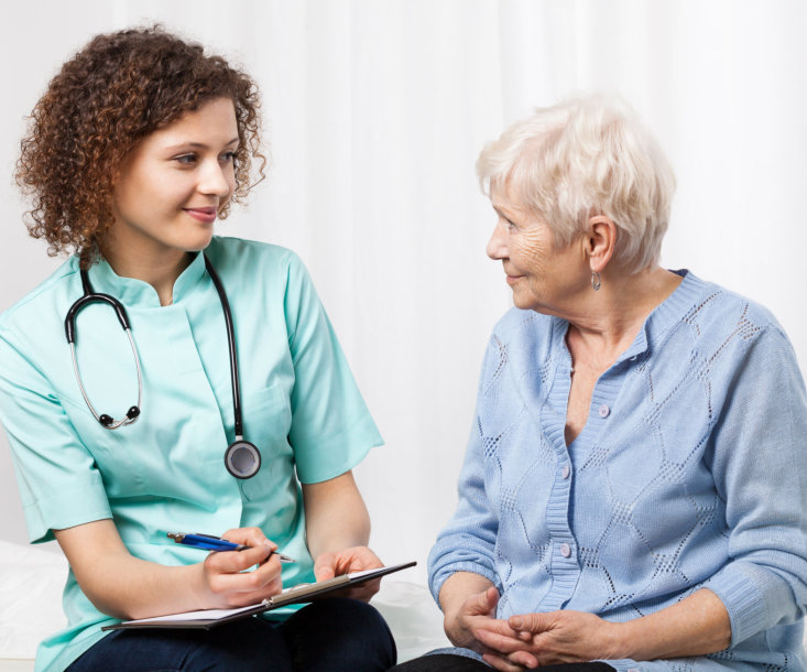 doctor examining the elderly woman